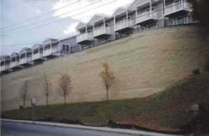 tall segmental retaining wall with parking above wall