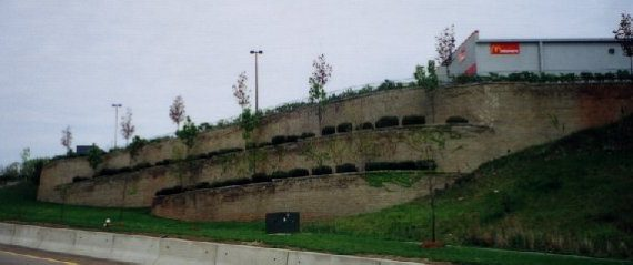 Tiered retaining wall with retail parking area above