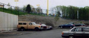 Retail parking area with segmental retaining wall abutting concrete panels